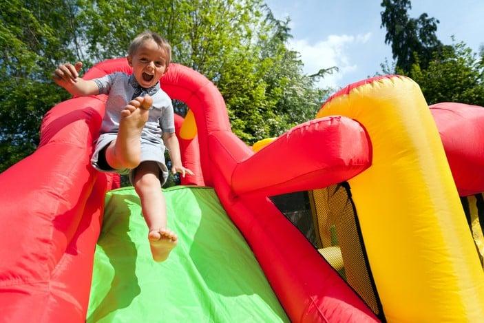 Boy on inflatable slide