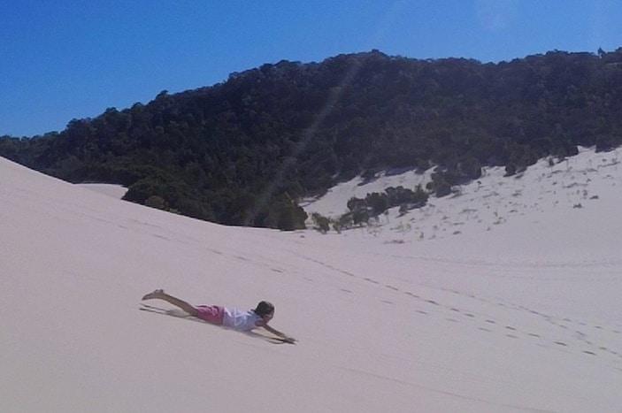 Sand tobogganing at Tangalooma